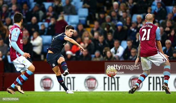 Aaron Cresswell of West Ham United scores his side's first goal during the Barclays Premier League match between Aston Villa and West Ham United at...