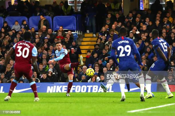 Aaron Cresswell of West Ham United scores his team's first goal during the Premier League match between Chelsea FC and West Ham United at Stamford...