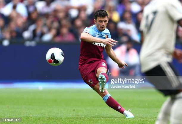 Aaron Cresswell of West Ham United scores his teams second goal during the Premier League match between West Ham United and Manchester United at...