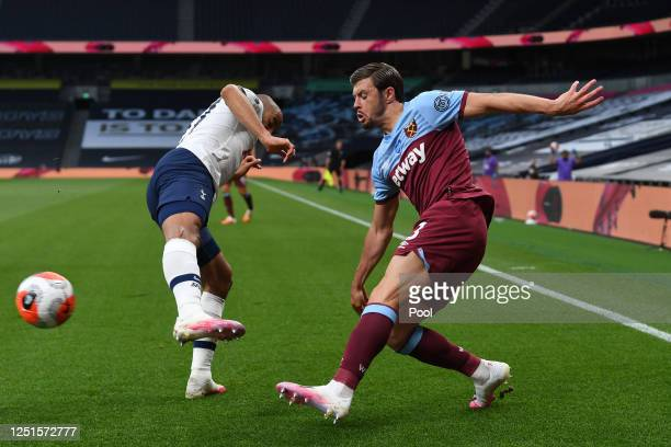 Aaron Cresswell of West Ham United shoots past Lucas Moura of Tottenham Hotspur during the Premier League match between Tottenham Hotspur and West...