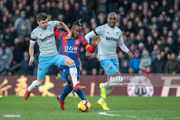 Aaron Cresswell of West Ham United tackle Michy Batshuayi of Crystal Palace during the Premier League match between Crystal Palace and West Ham...