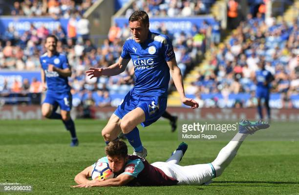 Aaron Cresswell of West Ham Unitited and Jamie Vardy of Leicester City collide during the Premier League match between Leicester City and West Ham...