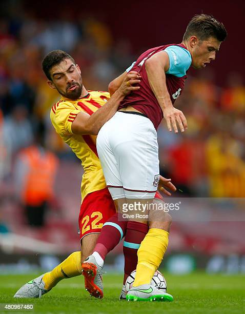 Aaron Creswell of West Ham United is challenged by Zach Muscat of FC Birkirkara during the UEFA Europa League second qualifying round match between...