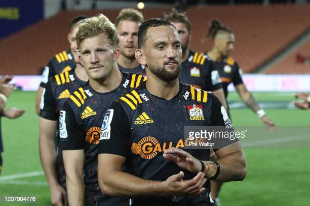 Aaron Cruden and Damian McKenzie of the Chiefs leave the field following the round four Super Rugby match between the Chiefs and the Brumbies at FMG...