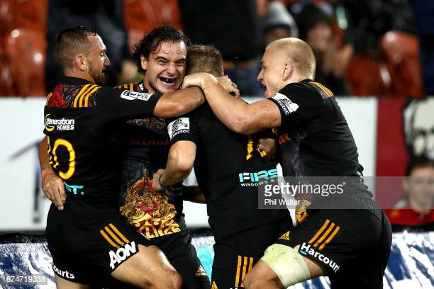 Aaron Cruden and James Lowe of the Chiefs celebrates a try to Damian McKenzie during the round 10 Super Rugby match between the Chiefs and the...