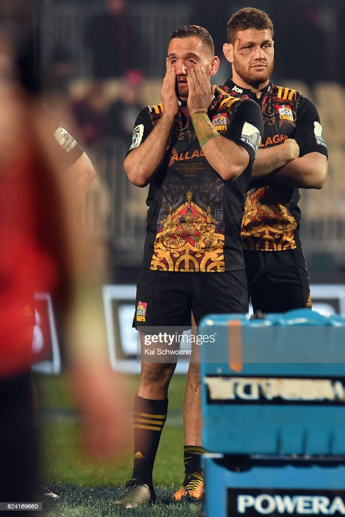Aaron Cruden and Tawera Kerr-Barlow of the Chiefs (L-R) look dejected after their loss in the Super Rugby Semi Final match between the Crusaders and the Chiefs at AMI Stadium on July 29, 2017 in Christchurch, New Zealand.