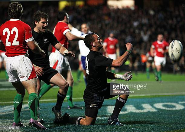 Aaron Cruden celebrates with Cory Jane of New Zealand after scoring during the test match between the New Zealand All Blacks and Wales at Waikato...