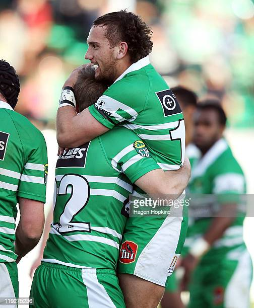 Aaron Cruden of Manawatu congratulates teammate Casey Stone on his try during the round one ITM Cup match between Manawatu and Hawke's Bay at FMG...