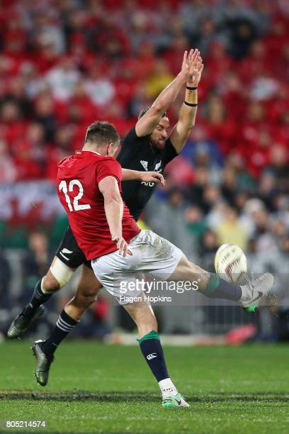 Aaron Cruden of New Zealand attempts to charge a kick by Owen Farrell of the Lions during the International Test match between the New Zealand All...