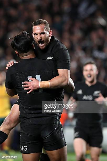 Aaron Cruden of the All Blacks celebrates with Julian Savea after he scores a try during the Bledisloe Cup Rugby Championship match between the New...