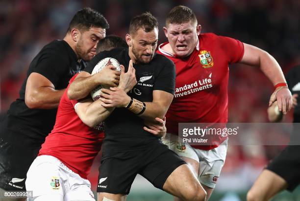 Aaron Cruden of the All Blacks drives on past Tadhg Furlong of the Lions during the first test match between the New Zealand All Blacks and the...