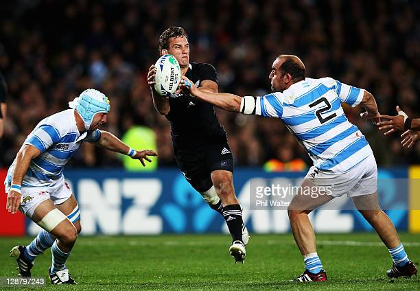 Aaron Cruden of the All Blacks is tackled by Mario Ledesma Arocena of Argentina during quarter final four of the 2011 IRB Rugby World Cup between New...