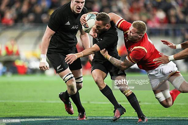 Aaron Cruden of the All Blacks is tackled high by Ross Moriarty of Wales during the International Test match between the New Zealand All Blacks and...