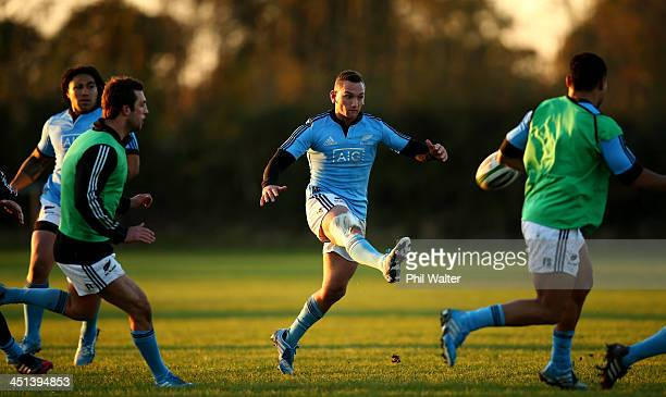 Aaron Cruden of the All Blacks kicks ahead during a New Zealand All Blacks training session at the Westmanstown Sport and Conference Centre on...