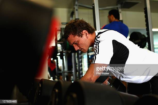 Aaron Cruden of the All Blacks lifts weights during a New Zealand IRB Rugby World Cup 2011 gym session at the AUT North Shore Campus on October 4...