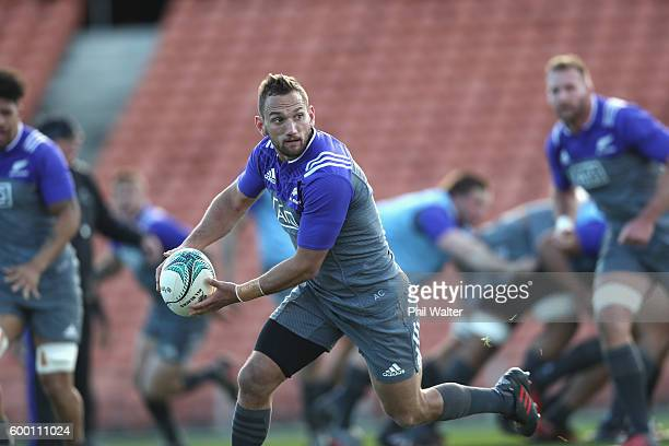 Aaron Cruden of the All Blacks runs with the ball during the New Zealand All Blacks training session at Waikato Stadium on September 8 2016 in...