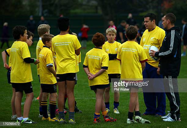 Aaron Cruden of the All Blacks tutors junior rugby players during a New Zealand All Blacks community activity session at Rugby Park on June 10, 2013...
