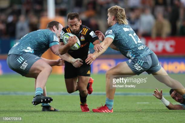 Aaron Cruden of the Chiefs is tackled during the round 2 Super Rugby match between the Chiefs and the Crusaders at FMG Stadium on February 08, 2020...