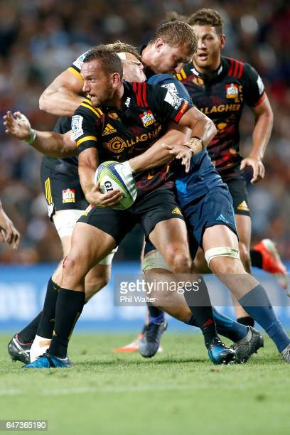 Aaron Cruden of the Chiefs is tackled during the round two Super Rugby match between the Chiefs and the Blues at Rugby Park on March 3 2017 in...