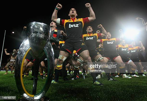 Aaron Cruden of the Chiefs leads the Haka as they celebrate winning the Super Rugby Final between the Chiefs and the Sharks at Waikato Stadium on...