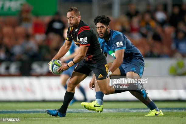 Aaron Cruden of the Chiefs looks to pass during the round two Super Rugby match between the Chiefs and the Blues at Rugby Park on March 3 2017 in...