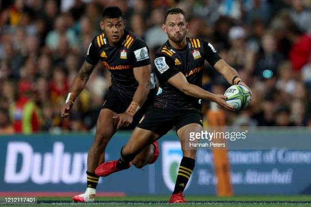 Aaron Cruden of the Chiefs makes a break during the round seven Super Rugby match between the Chiefs and the Hurricanes at Waikato Stadium on March...