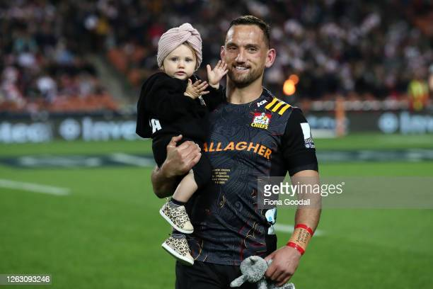 Aaron Cruden of the Chiefs runs out with his baby daughter for his 100th match for the Chiefs during the round eight Super Rugby Aotearoa match...