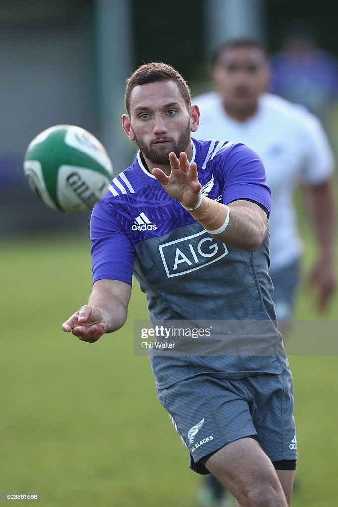 Aaron Cruden of the New Zealand All Blacks passes during a training session at the Westmanstown Sports Complex on November 17, 2016 in Dublin, Ireland.