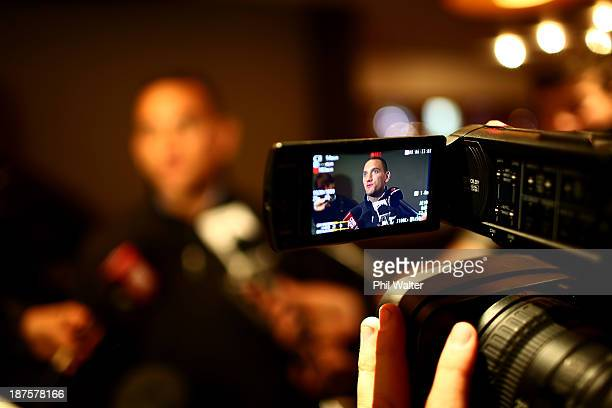 Aaron Cruden of the New Zealand All Blacks speaks to media upon arrival at the Royal Garden Hotel on November 10 2013 in London England