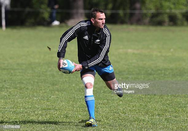 Aaron Cruden passes the ball during a New Zealand All Blacks training session held at St George's College on September 25 2012 in Buenos Aires...