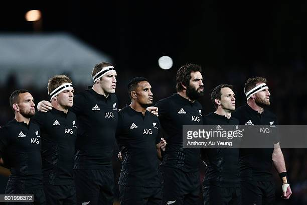 Aaron Cruden Sam Cane Brodie Retallick Jerome Kaino Sam Whitelock Ben Smith and Kieran Read stand for the national anthem during the Rugby...