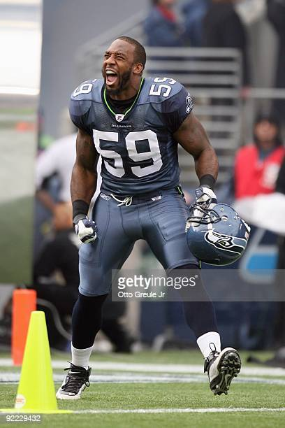 8837398164e Aaron Curry of the Seattle Seahawks celebrates as he enters the field  before the game against