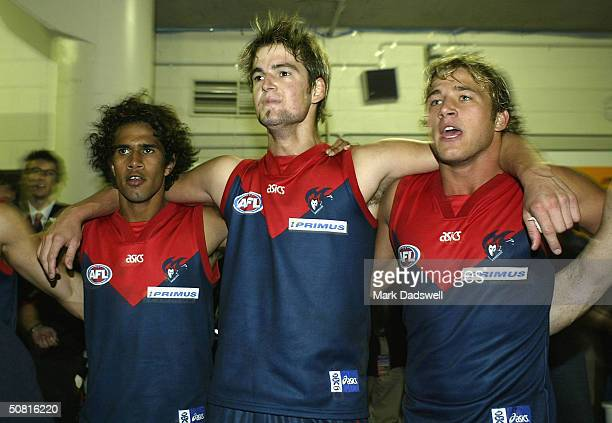 Aaron Davey Jared Rivers and Steven Armstrong for the Demons celebrate after winning the round seven AFL match between the Melbourne Demons and the...