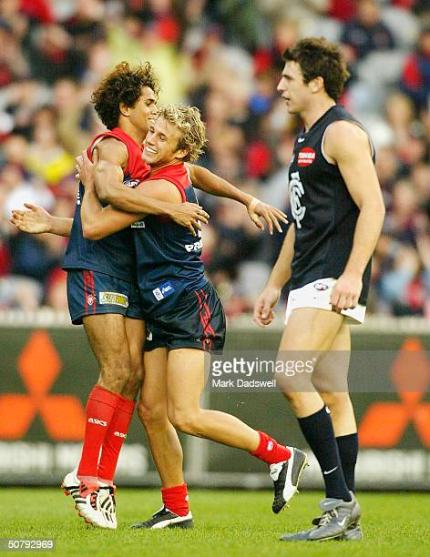Aaron Davey number 36 and Steven Armstrong number 2 for the Demons celebrate a goal during the round six match between the Melbourne Demons and the...