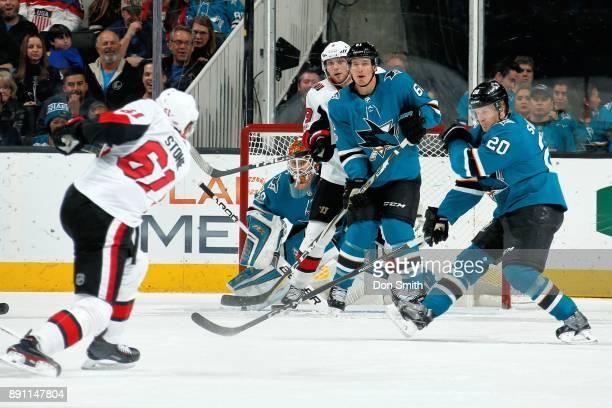 Aaron Dell Justin Braun and Marcus Sorensen of the San Jose Sharks defend Mark Stone and Bobby Ryan of the Ottawa Senators at SAP Center on December...