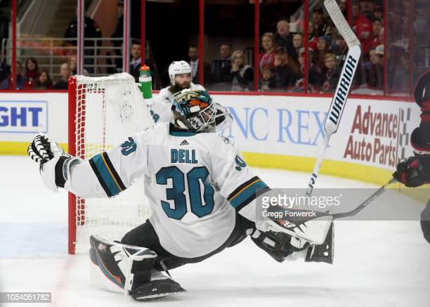Aaron Dell of the San Jose Sharks comes out of the crease and keeps his eye on the puck during an NHL game against the Carolina Hurricanes on October...