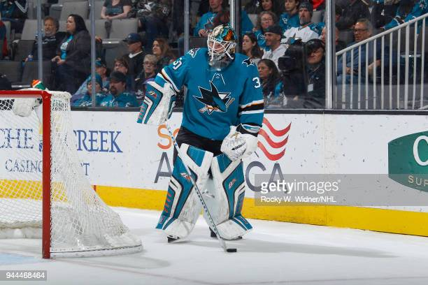 Aaron Dell of the San Jose Sharks controls the puck against the Minnesota Wild at SAP Center on April 7 2018 in San Jose California Aaron Dell