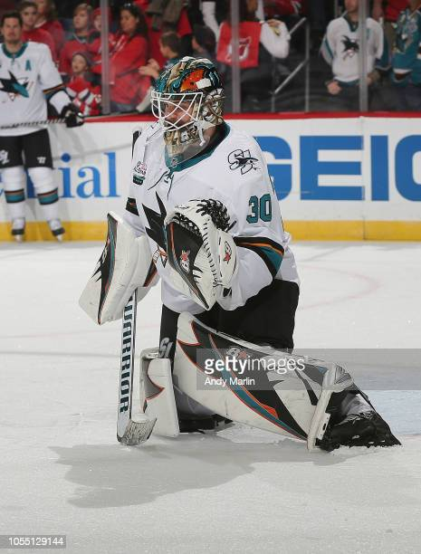 Aaron Dell of the San Jose Sharks defends his net during warmups prior to the game against the New Jersey Devils at Prudential Center on October 14...