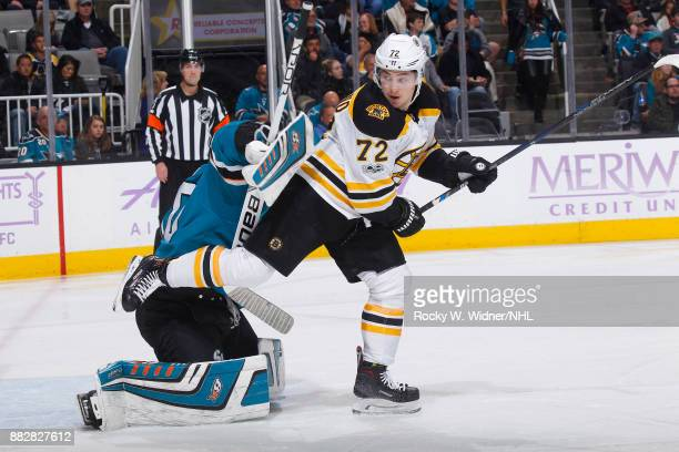 Aaron Dell of the San Jose Sharks defends the net against Frank Vatrano of the Boston Bruins at SAP Center on November 18 2017 in San Jose California