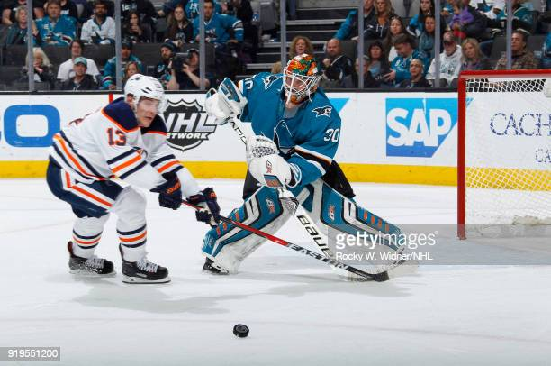 Aaron Dell of the San Jose Sharks defends the net against Michael Cammalleri of the Edmonton Oilers at SAP Center on February 10 2018 in San Jose...