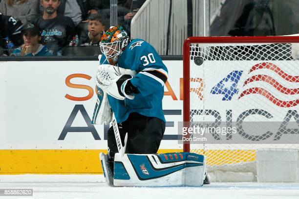 Aaron Dell of the San Jose Sharks deflects the puck during a NHL game against the Los Angeles Kings at SAP Center at San Jose on October 7 2017 in...
