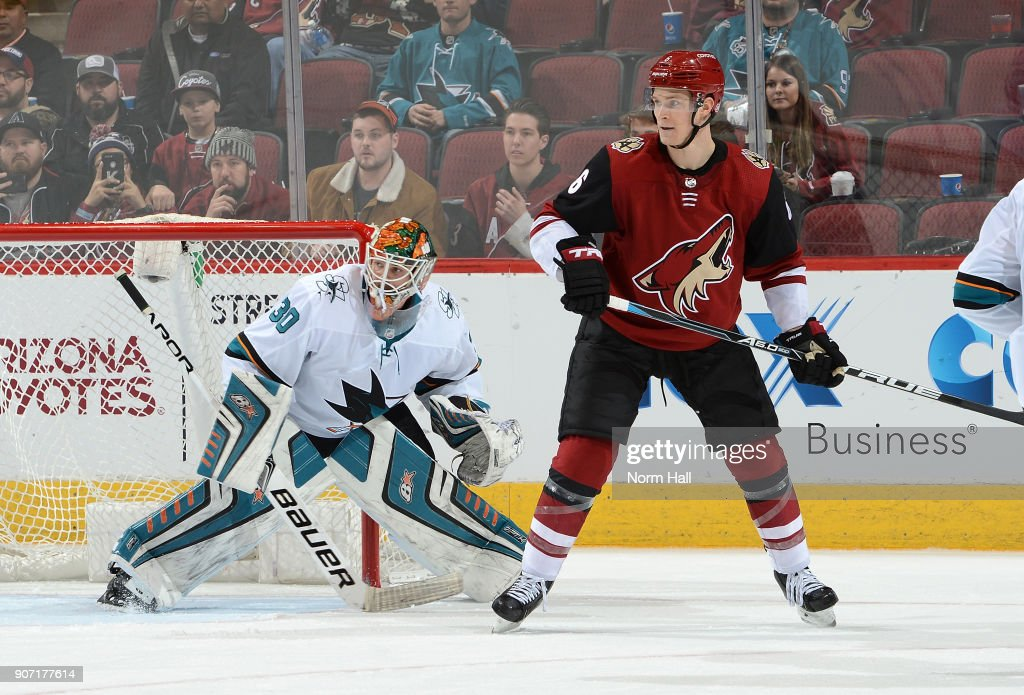 Aaron Dell #30 of the San Jose Sharks gets ready to make a save as Jakob Chychrun #6 of the Arizona Coyotes looks for teh puck at Gila River Arena on January 16, 2018 in Glendale, Arizona.