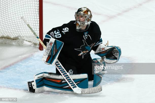 Aaron Dell of the San Jose Sharks looks during a NHL game against the Vancouver Canucks at SAP Center at San Jose on March 2 2017 in San Jose...