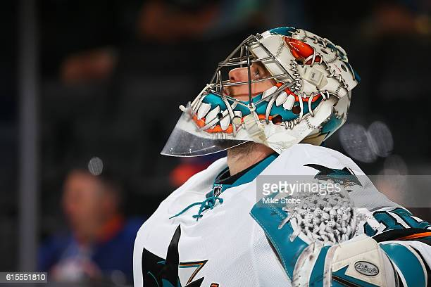 Aaron Dell of the San Jose Sharks looks on against the New York Islanders at the Barclays Center on October 18 2016 in Brooklyn borough of New York...