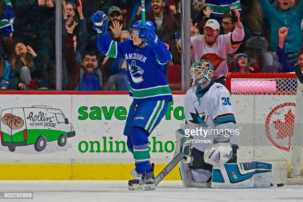 Aaron Dell of the San Jose Sharks looks on dejected as Jake Virtanen of the Vancouver Canucks celebrates after a Vancouver goal during their NHL game...