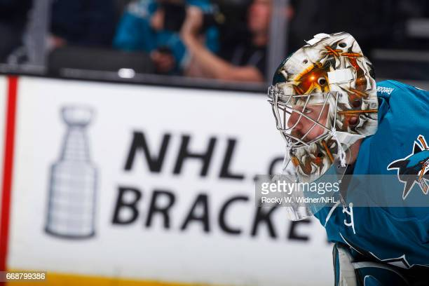 Aaron Dell of the San Jose Sharks looks on during the game against the Calgary Flames at SAP Center on April 8 2017 in San Jose California