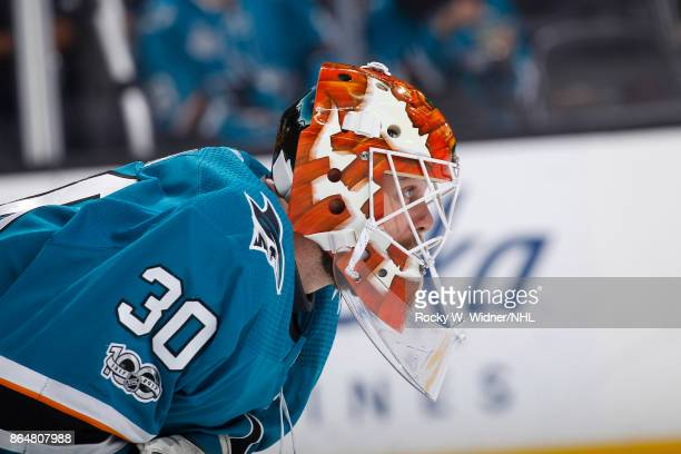 Aaron Dell of the San Jose Sharks looks on during the game against the New York Islanders at SAP Center on October 14 2017 in San Jose California
