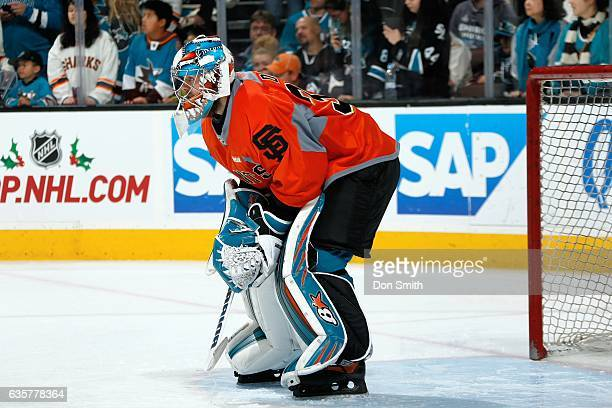 Aaron Dell of the San Jose Sharks looks on during warmups wearing a commemorative San Francisco Giants''NHL jersey prior to a NHL game against the...