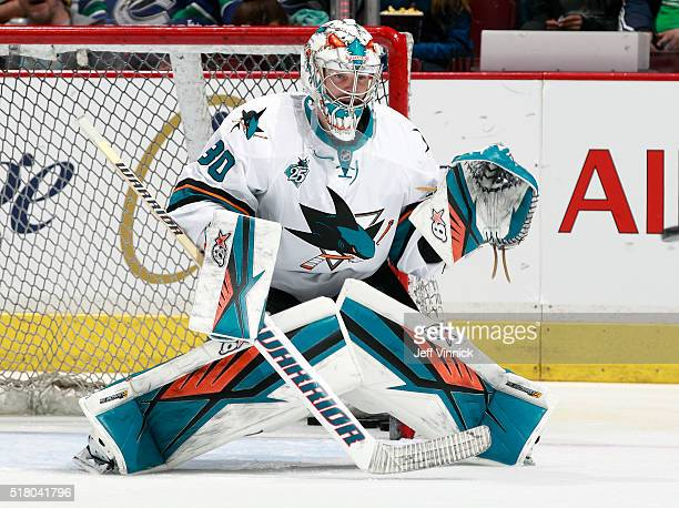 Aaron Dell of the San Jose Sharks looks on from his crease during their NHL game against the Vancouver Canucks at Rogers Arena February 28 2016 in...