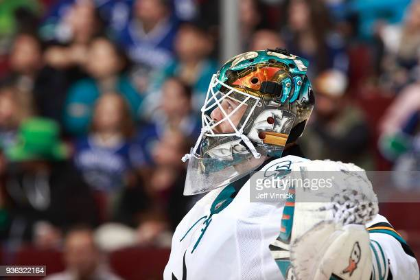 Aaron Dell of the San Jose Sharks looks on from his crease during their NHL game against the Vancouver Canucks at Rogers Arena March 17 2018 in...